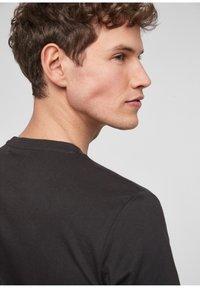 s.Oliver - Print T-shirt - black - 5