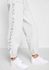 Nike Sportswear - Tracksuit bottoms - light bone - 3