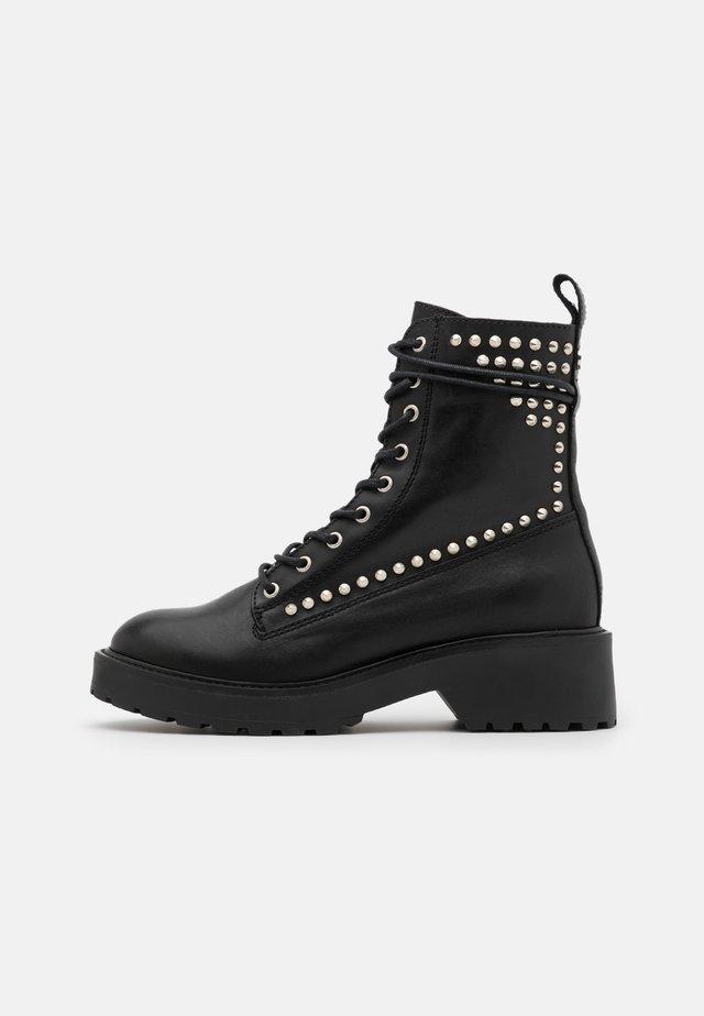 TORNADO - Platform ankle boots - black