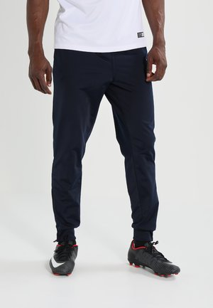 CLASSICO - Tracksuit bottoms - marine