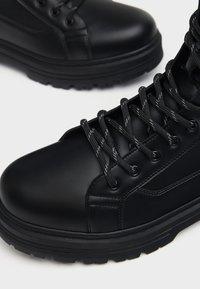 Bershka - Cowboy/biker ankle boot - black - 4