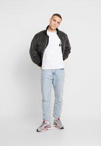 Calvin Klein Jeans - MIRRORED MONOGRAM SLIM TEE - T-shirt con stampa - bright white/black - 1