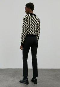 EDITED - BRIDGET - Trousers - schwarz - 2