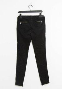 KARL LAGERFELD - Trousers - black - 1