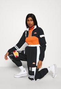 Ellesse - OLTUS TRACK PANT - Pantalones deportivos - black - 5