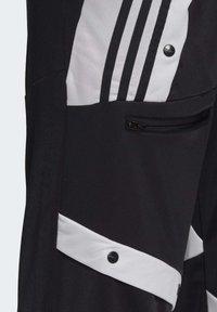 adidas Originals - DANIËLLE CATHARI JOGGERS - Pantalon de survêtement - black - 5
