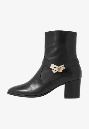 MID LOCK - Classic ankle boots - black/gold
