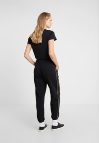 Polo Ralph Lauren - SEASONAL  - Pantalon de survêtement - black - 2