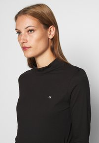 Calvin Klein - LIQUID TOUCH TURTLE NECK - Long sleeved top - black - 4