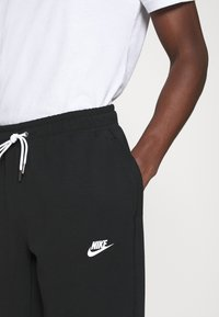 Nike Sportswear - MODERN  - Träningsbyxor - black - 4