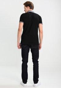 Carhartt WIP - REBEL PANT SPICER - Slim fit jeans - blue one wash - 2