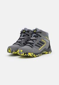 adidas Performance - TERREX HYPERHIKER TRAXION HIKING SHOES UNISEX - Hiking shoes - grey four/core black/grey three - 1