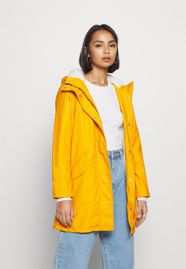ONLSALLY RAINCOAT - Parka - golden yellow/white