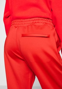 Lacoste - HF5430-00 - Tracksuit bottoms - red - 3