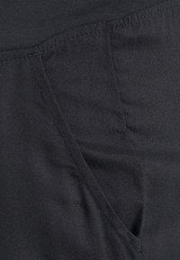 Noppies Studio - SALE - Spodnie materiałowe - black - 2