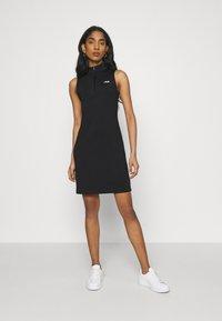 Fila - CEARA TIGHT DRESS - Pouzdrové šaty - black - 0