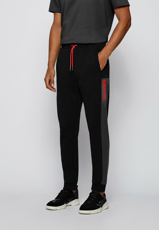 HADIKO  - Pantalon de survêtement - black