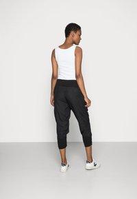 Cream - LINE PANTS - Trousers - solid black - 2