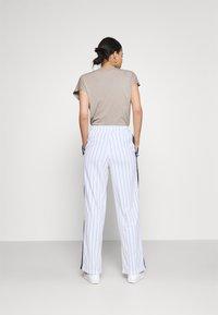 Fila - HALA TRACK PANTS - Trousers - blanc de blanc/black iris - 2