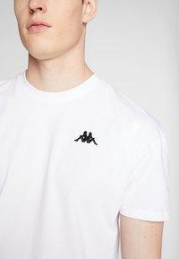 Kappa - FRANKLYN - Basic T-shirt - bright white - 4