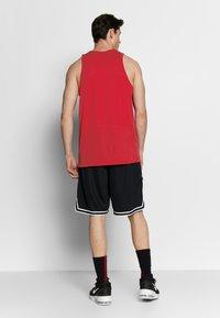 Nike Performance - DRY CROSSOVER - Tekninen urheilupaita - university red/white - 2