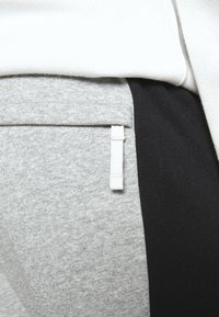 Nike Sportswear - Tracksuit bottoms - dark grey heather/white/black - 5