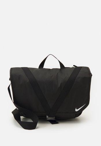 SPORTSWEAR ESSENTIALS UNISEX - Across body bag - black/white