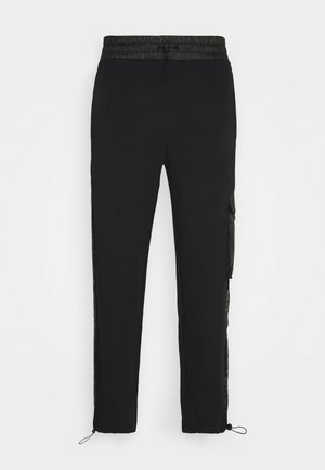 DURIMI - Tracksuit bottoms - black