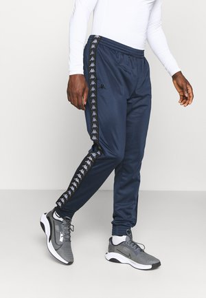 JELGE - Tracksuit bottoms - total eclipse