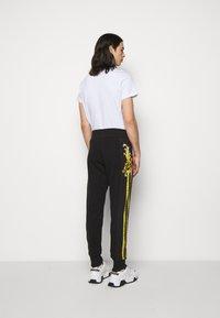 Versace Jeans Couture - Tracksuit bottoms - black - 2