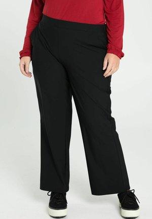TRAVELWEAR - Trousers - black