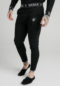 SIKSILK - LOUNGE PANTS - Tracksuit bottoms - black - 0