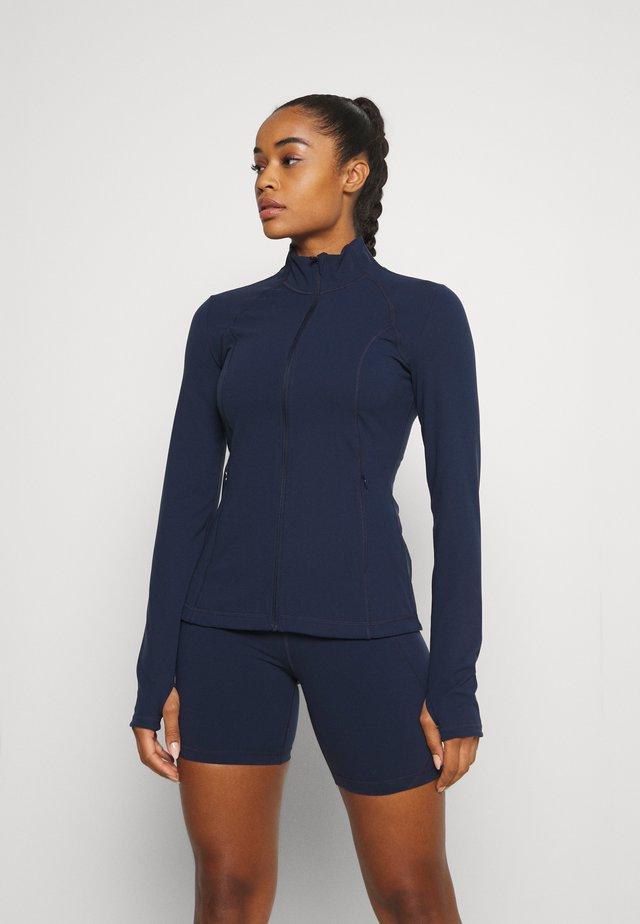 POWER WORKOUT ZIP THROUGH JACKET - Training jacket - navy blue