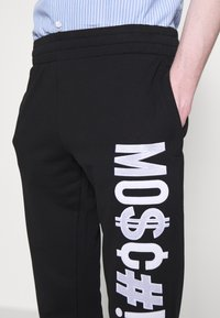 MOSCHINO - TROUSERS - Tracksuit bottoms - black - 8