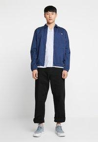 Carhartt WIP - SINGLE KNEE PANT DEARBORN - Jeans Straight Leg - black rinsed - 1