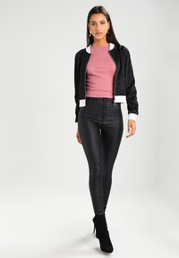 Urban Classics - LADIES BUTTON UP TRACK JACKET - Bomber Jacket - black/white - 1