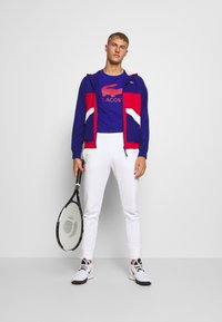 Lacoste Sport - TENNIS JACKET - Training jacket - cosmic/red/white - 1