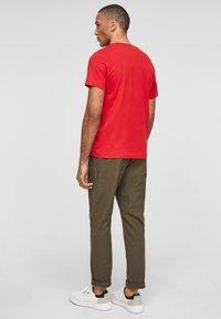 s.Oliver - MIT SCHRIFTPRINT - Print T-shirt - red - 3