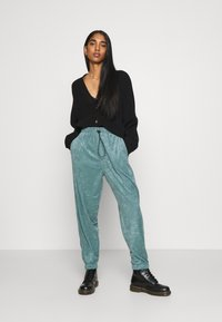 Topshop - TOWLLING JOGGER - Tracksuit bottoms - ice blue - 1
