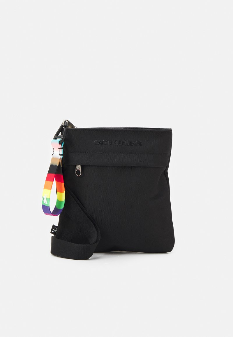 Calvin Klein Jeans - PRIDE MICRO FLAT PACK UNISEX - Across body bag - black