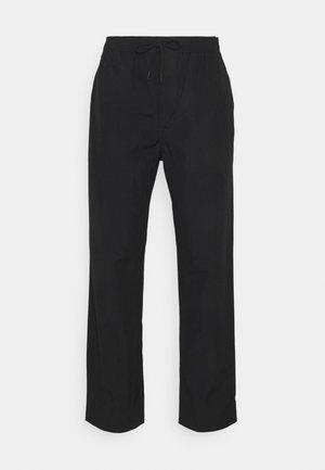 JABARI TROUSERS - Trousers - black