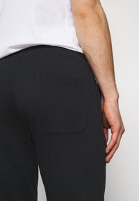Jack & Jones - JORSCRIPTT PANTS  - Verryttelyhousut - black - 5