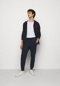 HUGO - DOAK - Teplákové kalhoty - dark blue - 1