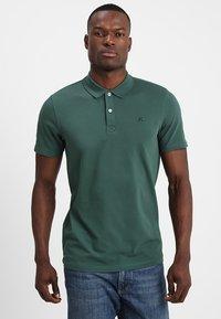 Selected Homme - SLHLUKE SLIM FIT - Polo shirt - trekking green - 0