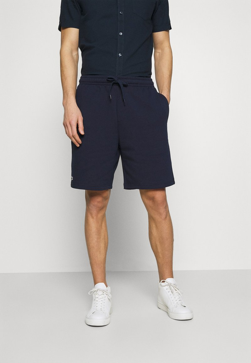 Lacoste - Tracksuit bottoms - navy blue