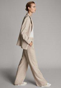 Massimo Dutti - MELIERTE  - Trousers - beige - 3