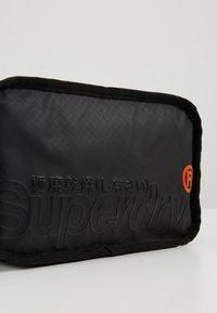 Superdry - TARP WASH BAG - Wash bag - black - 2