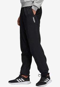 adidas Performance - ESSENTIALS PLAIN STANFORD TROUSERS - Spodnie treningowe - black - 2