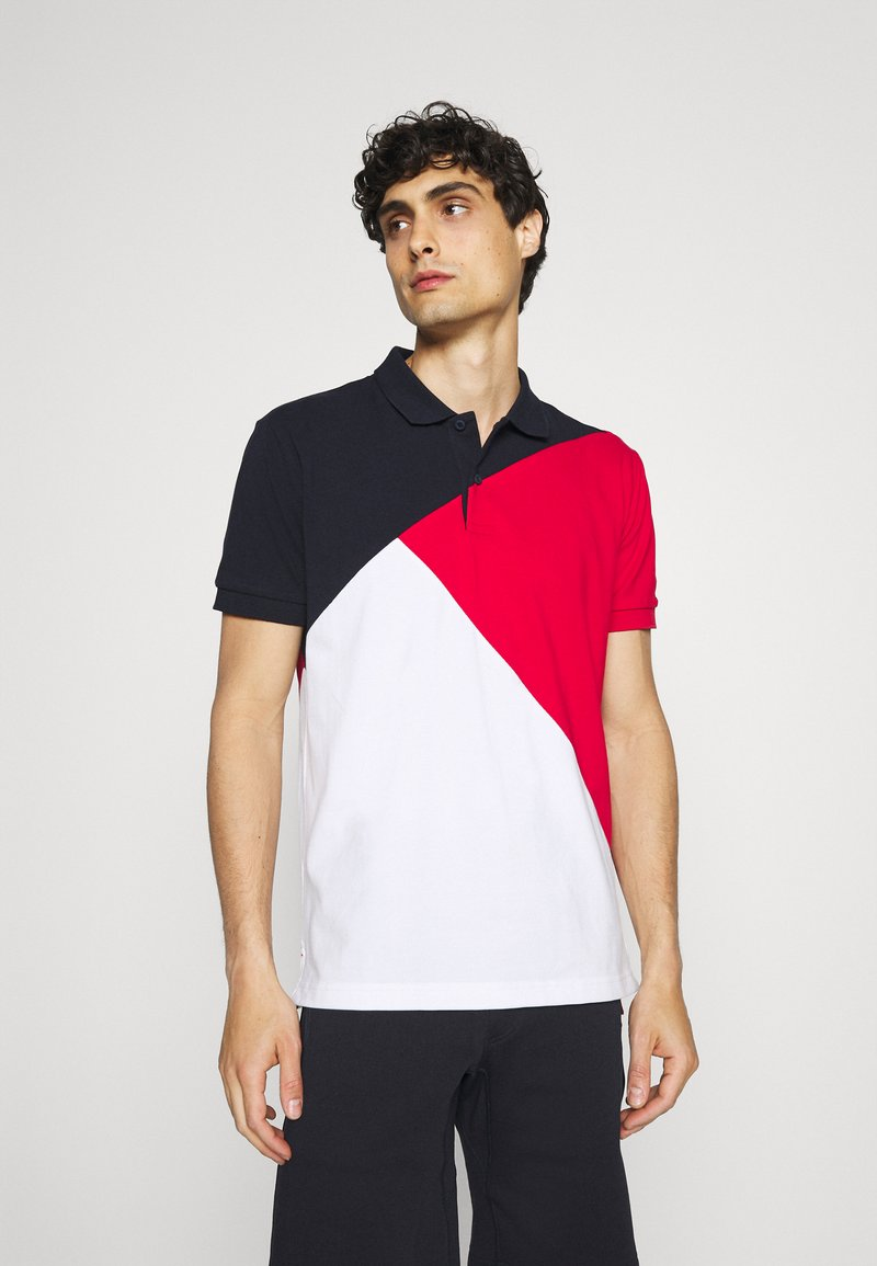 Tommy Hilfiger - DIAGONAL COLORBLOCK REGULAR - Polo shirt - desert sky/white/primary red