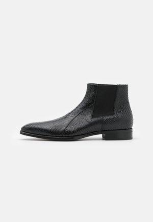 Kotníkové boty - pitone nero